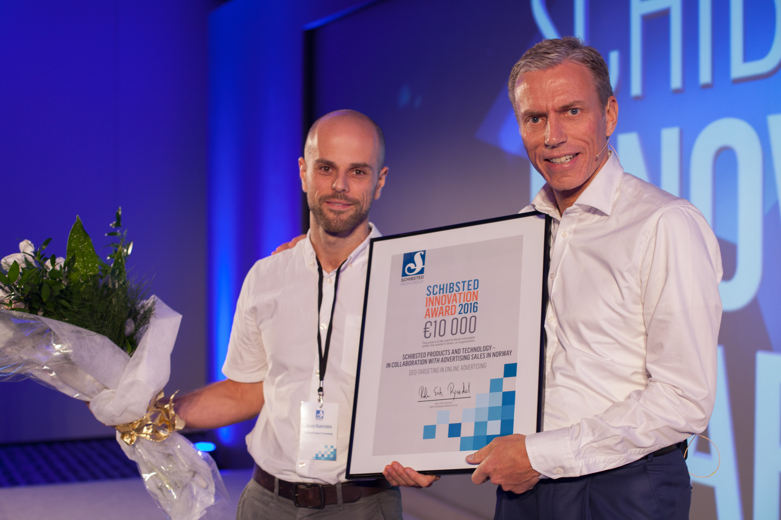 Caption: Nuno Guerreiro (L) of Schibsted Product and Tech accepts the 2016 Schibsted Innovation Award from Rolv Erik Ryssdal (R), CEO of Schibsted Media Group